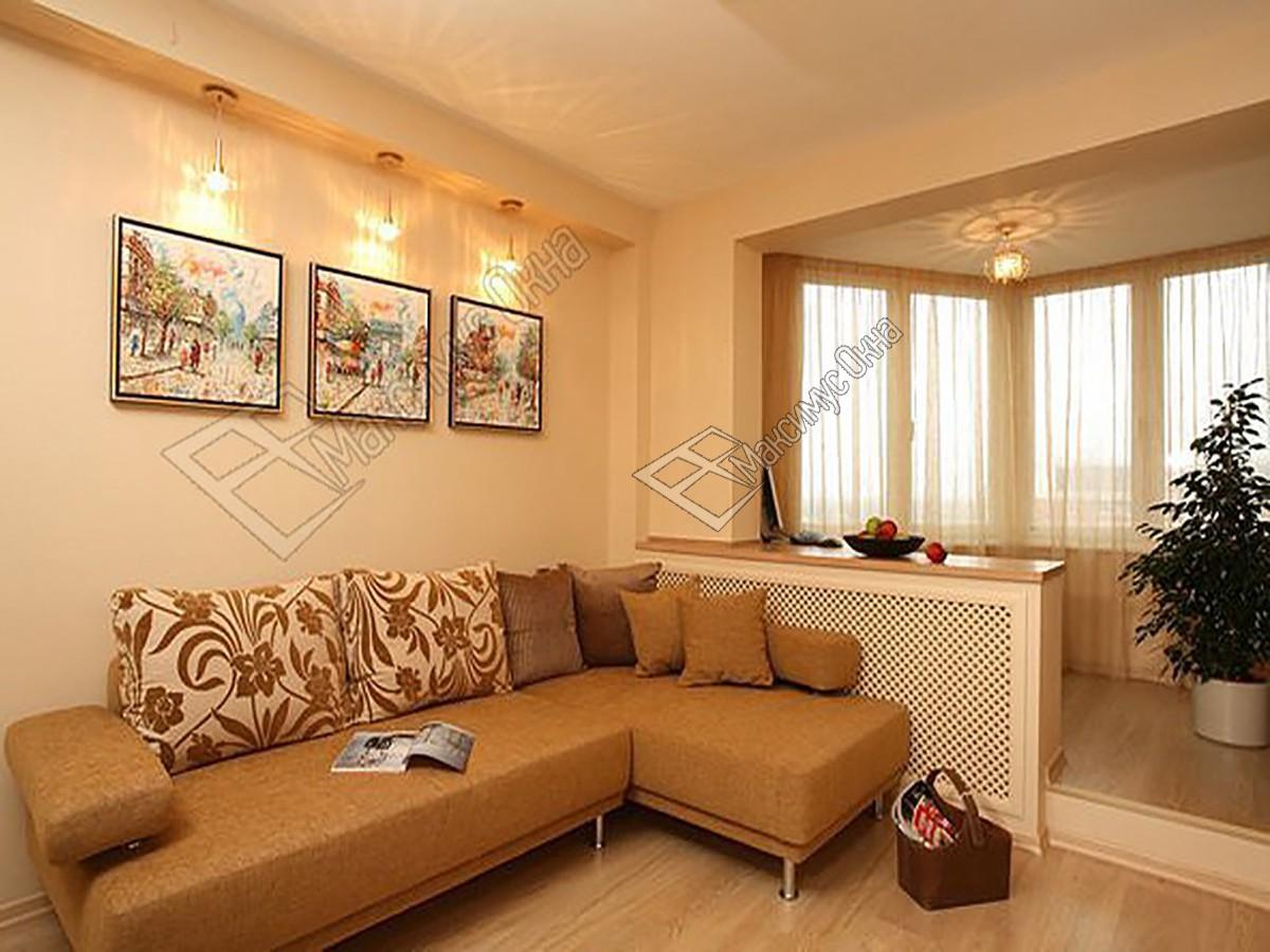 Дизайн гостиной с балконом kakoiremont.ru.